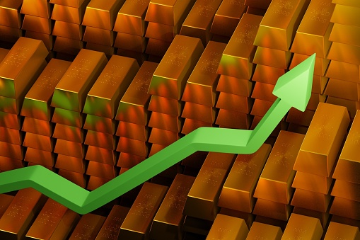 831745600 istock photo Gold prices soaring in a bullish market. Green arrow going up over gold bars. Concept digital 3D render. 1222280038