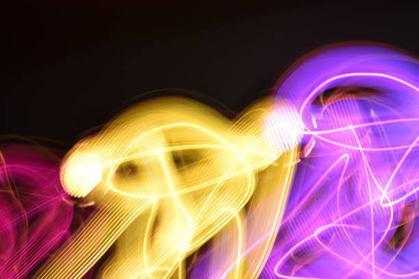 gold, purple and berry light grid trails - steven harrie stock photos and pictures