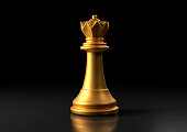 Gold queen chess, standing against black background