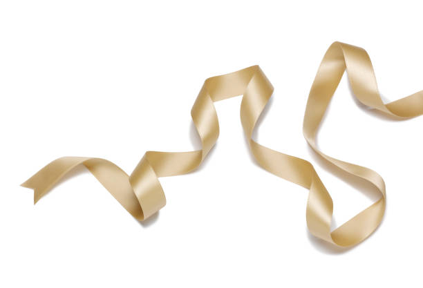 gold ribbon - ribbon sewing item stock photos and pictures