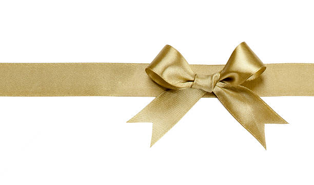 Gold ribbon with bow isolated stock photo