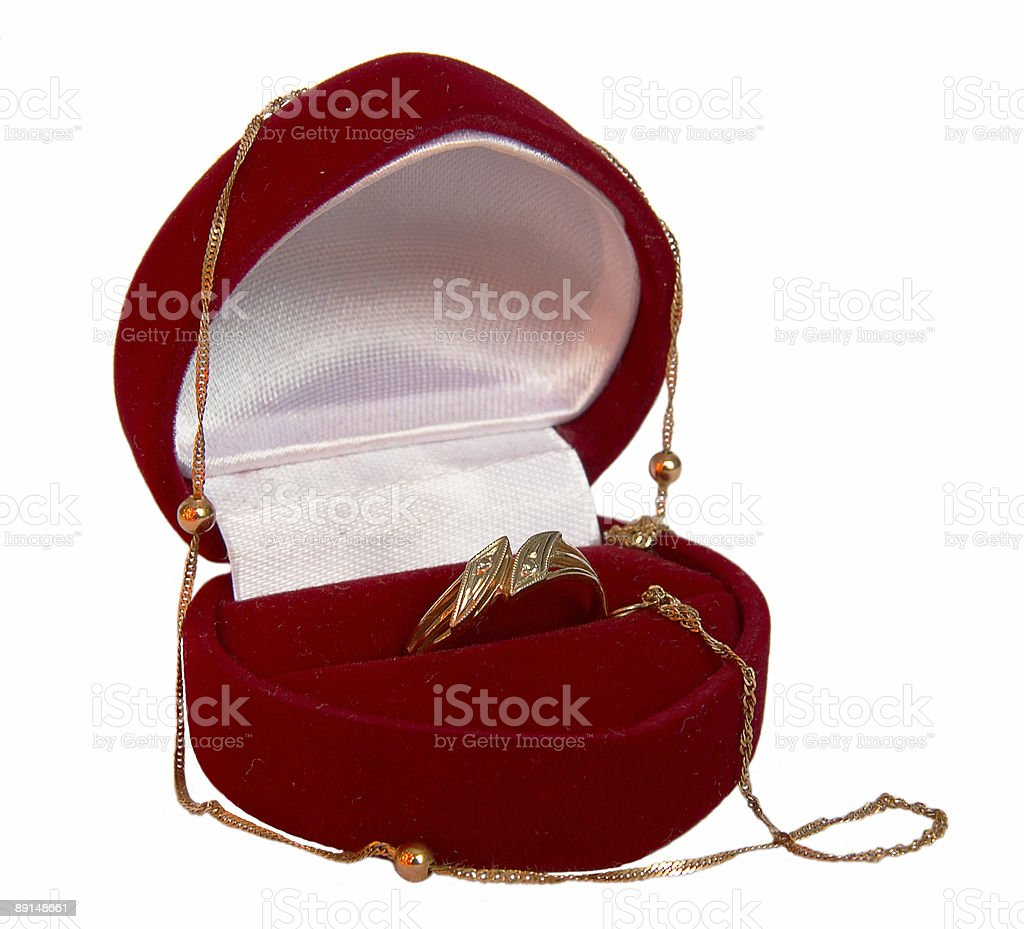 gold ring and chain in velvet box (heart form) (isolated) stock photo