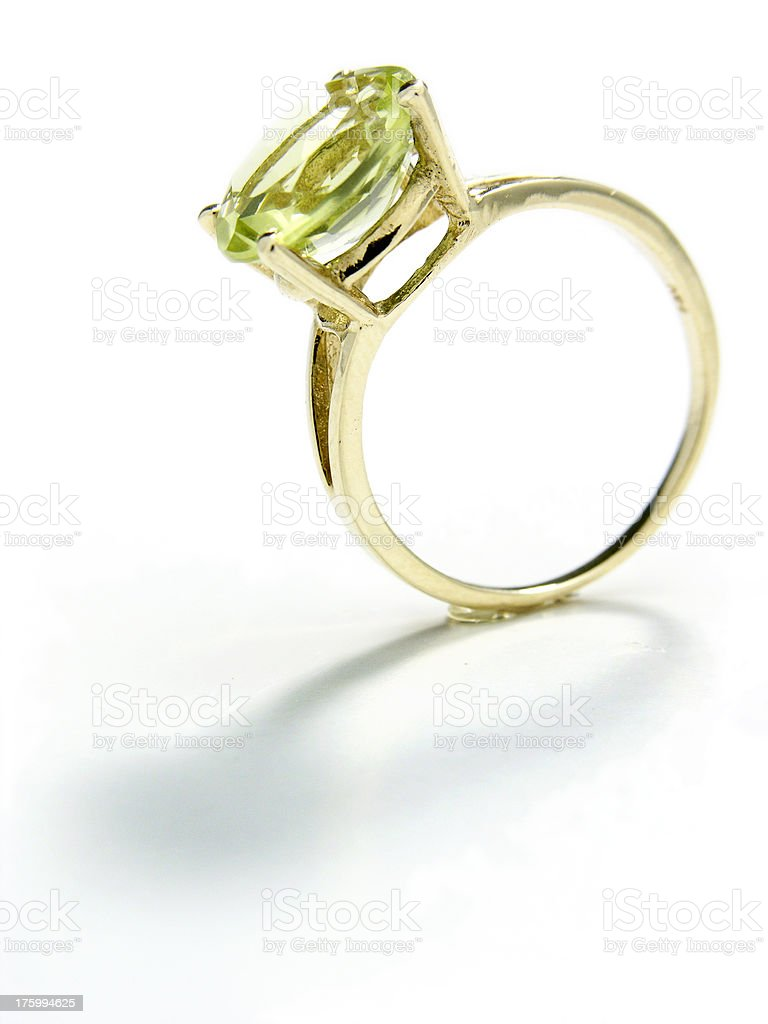Gold ring with green gem, clipping path royalty-free stock photo