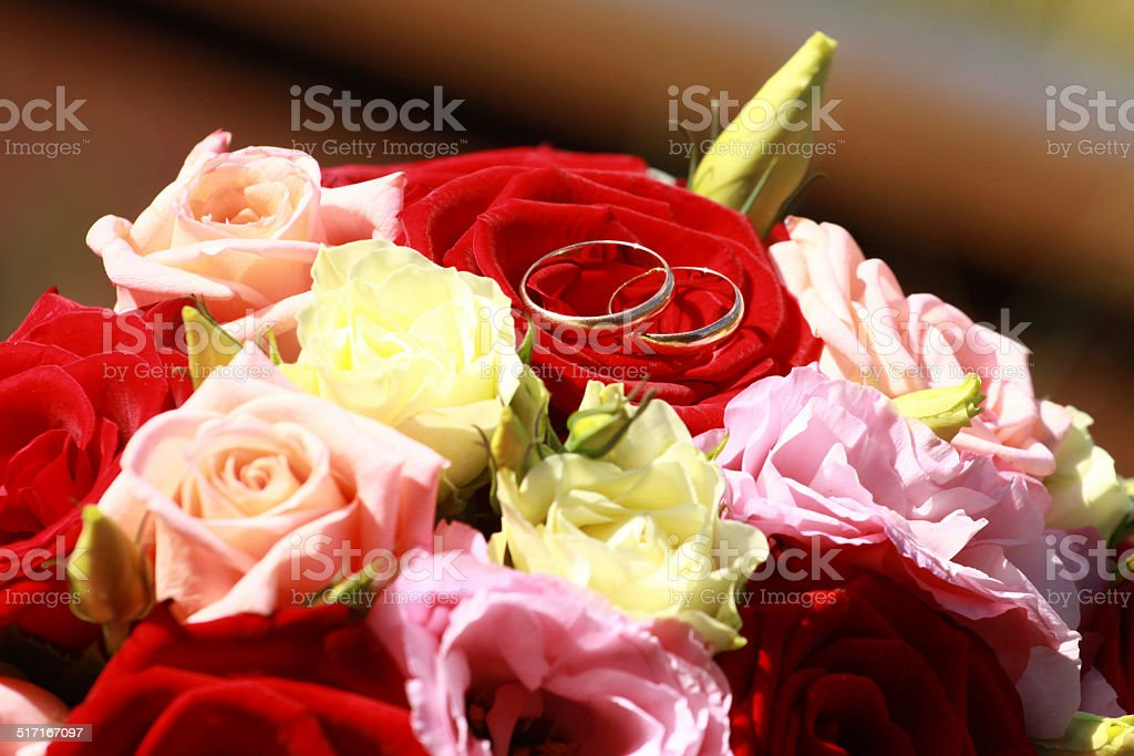 Gold rings on a bouquet royalty-free stock photo
