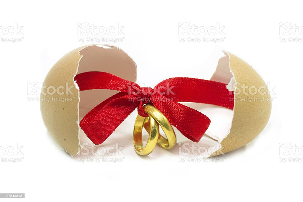 Gold rings tied with red ribbon royalty-free stock photo