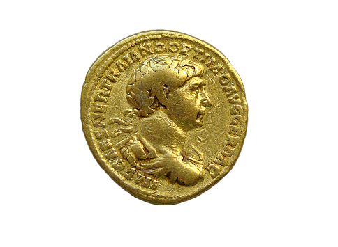 Gold Roman aureus coin of Roman emperor Trajan AD 98-117 isolated on a white background