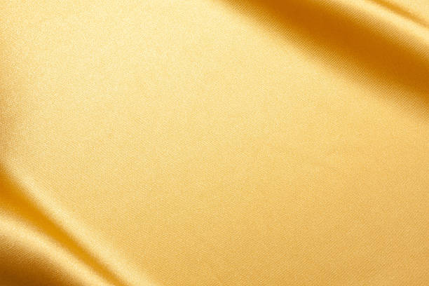 gold satin background textured - textile stock photos and pictures