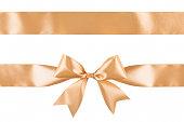 istock Gold satin ribbon bow isolated on white background 1079762512