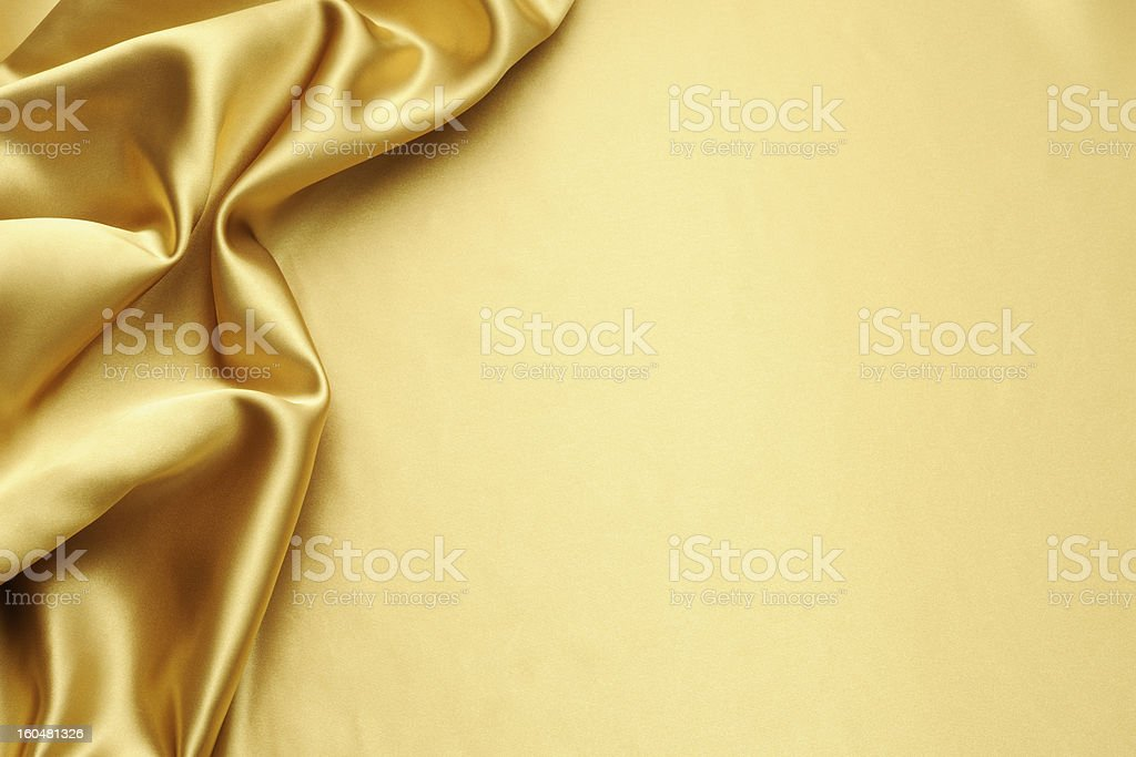 Gold satin texture background with copy space stock photo