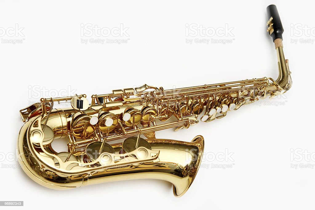 Gold saxophone laying on white background stock photo