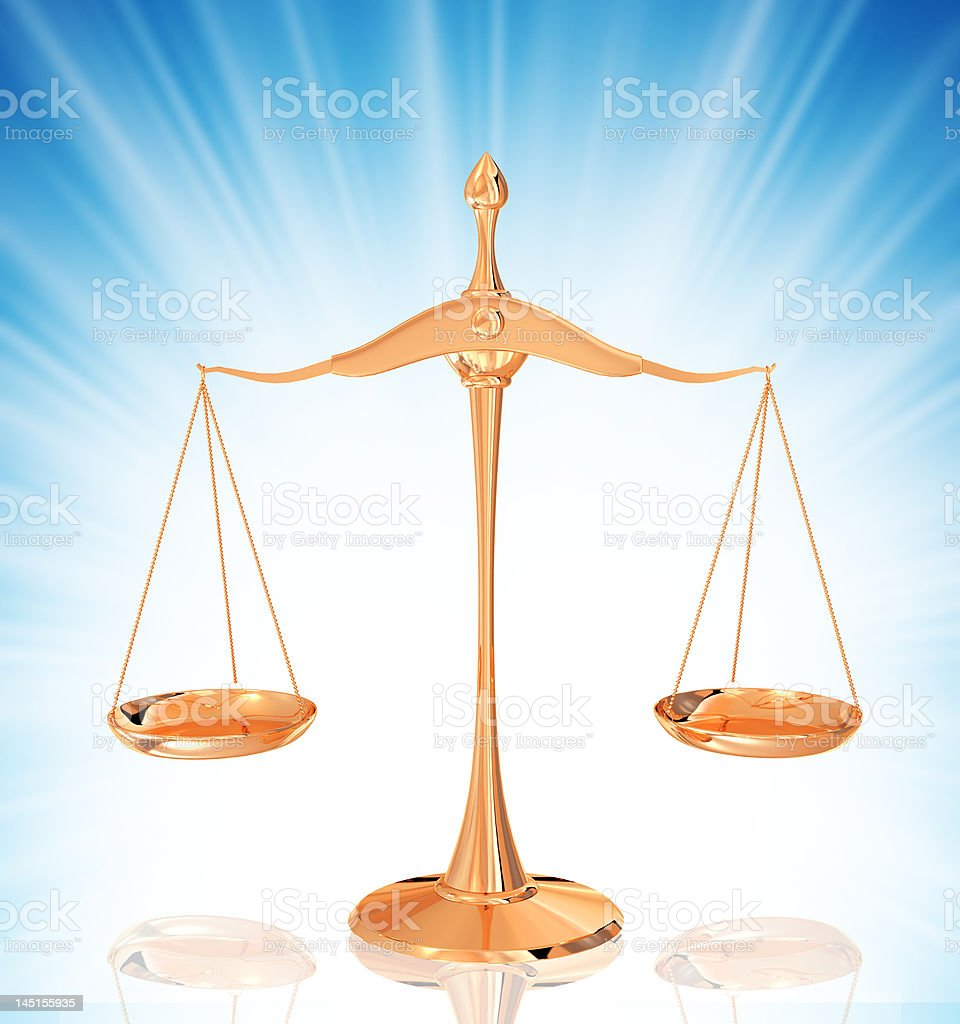 gold scales isolated on background royalty-free stock photo