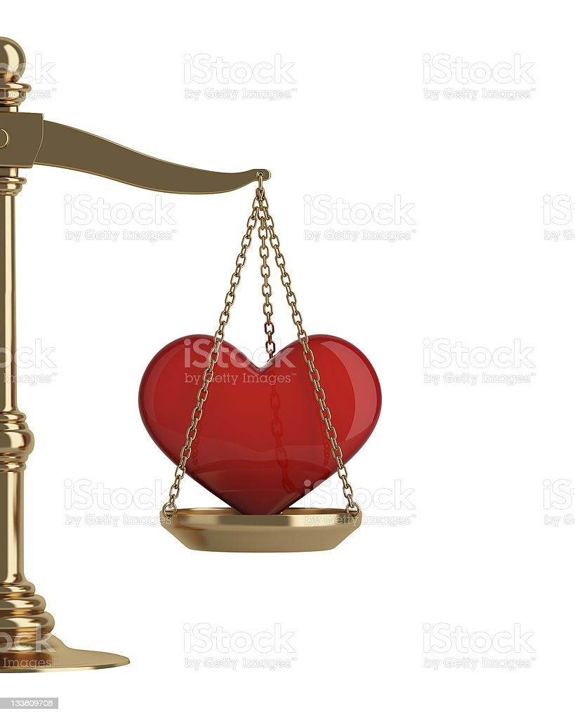 Gold scales with heart royalty-free stock photo