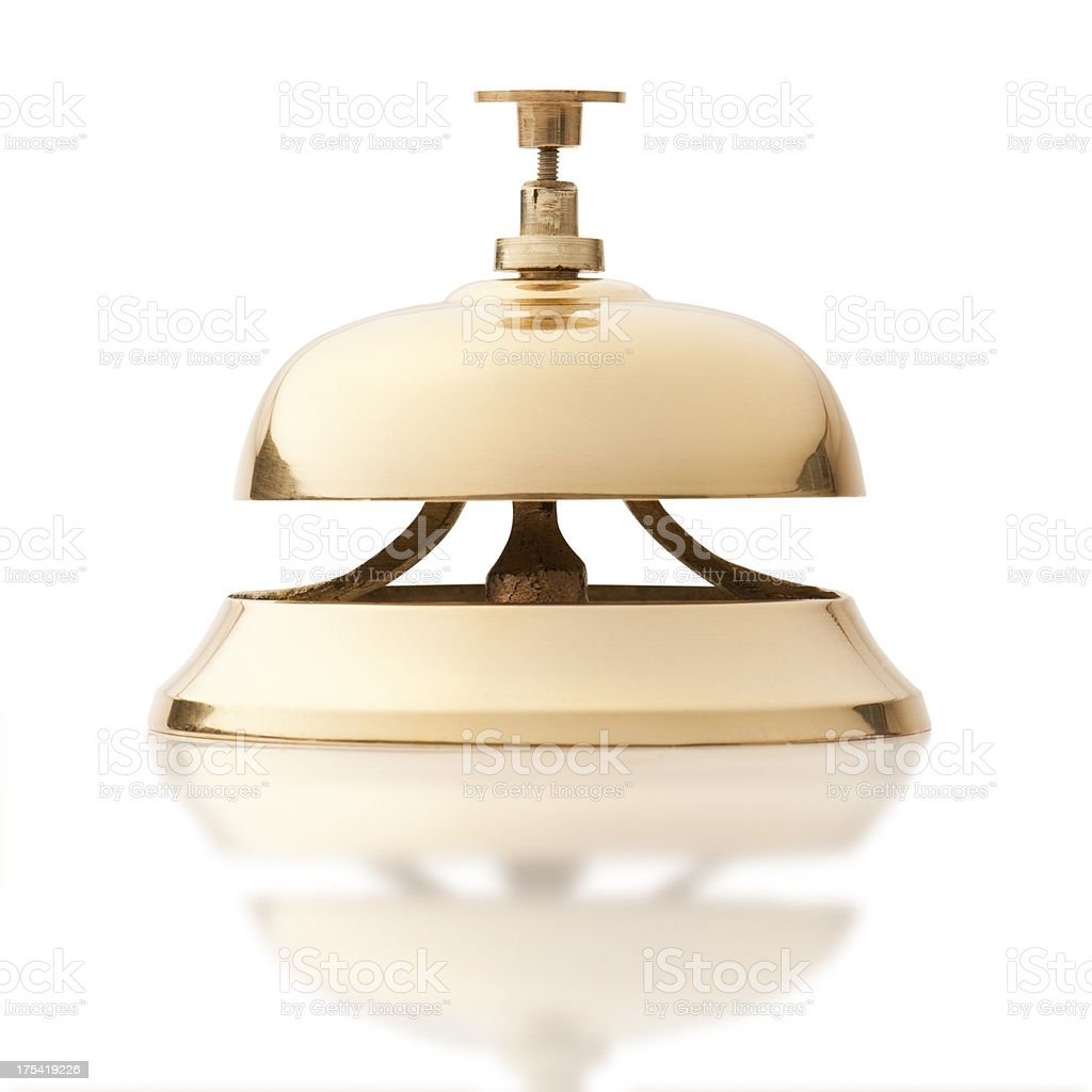 Gold service bell isolated on white background stock photo