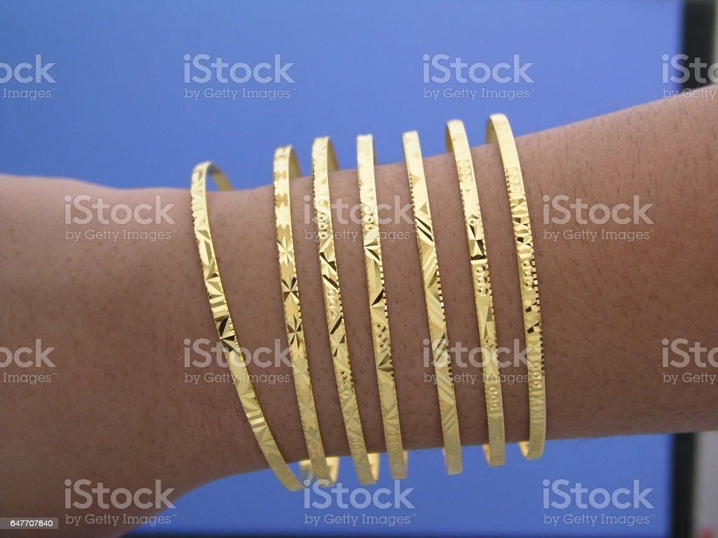 Gold seven day Bangle bracelet stock photo