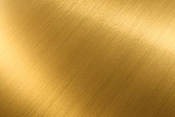 gouden glanzende textuur achtergrond - goud metaal stockfoto's en -beelden