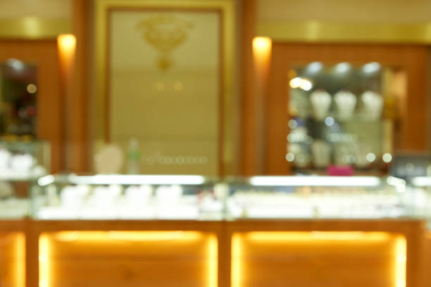 Gold Shop Blurred background View of a gold jewellery store as gold prices, jeweller stock pictures, royalty-free photos & images