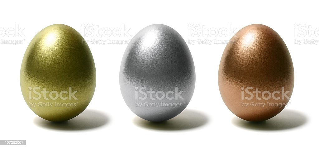 Gold Silver and Bronze Eggs on White Background stock photo