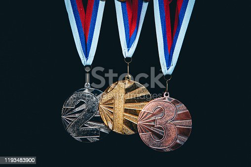 544347868 istock photo Gold, silver and Bronze medal, sport trophy photo, black background 1193483900