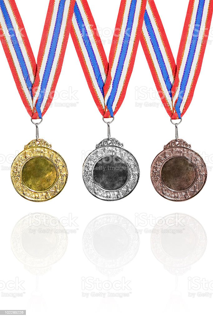 Gold, silver and bronze medals stock photo