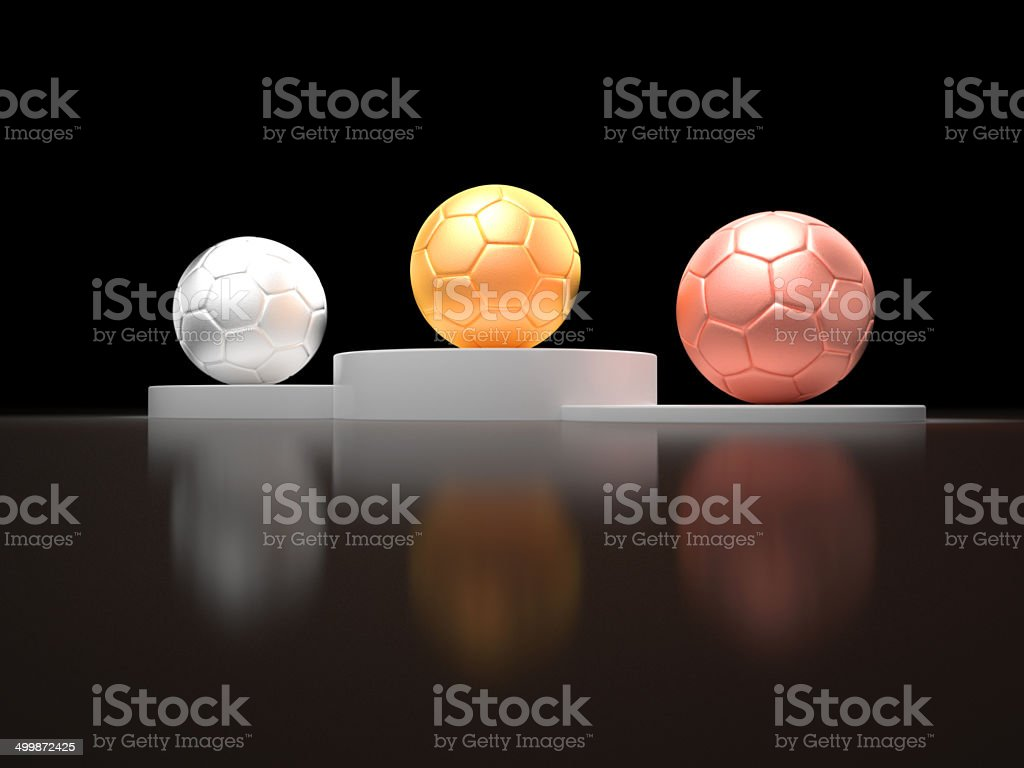 Gold silver and bronze soccer ball on a victory podium stock photo