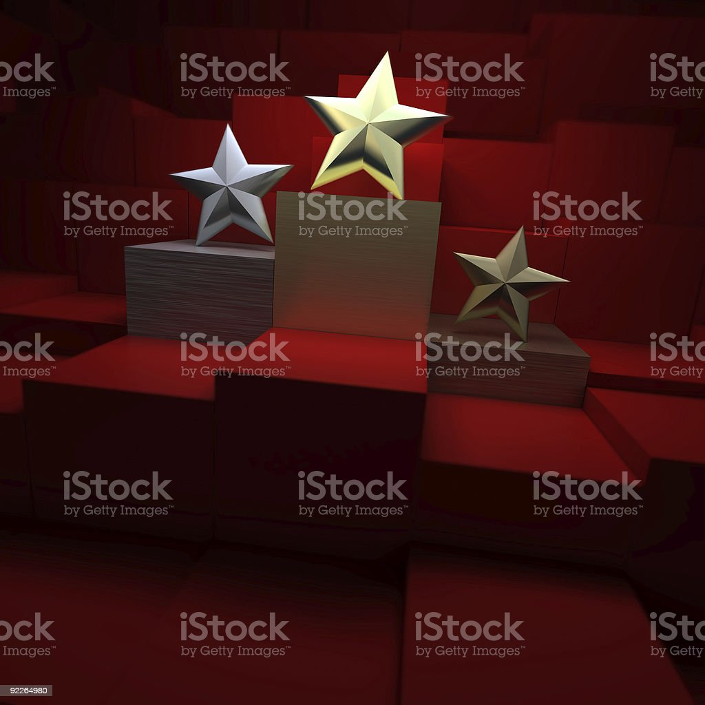 Gold, silver, and bronze stars depicting awards on podiums stock photo
