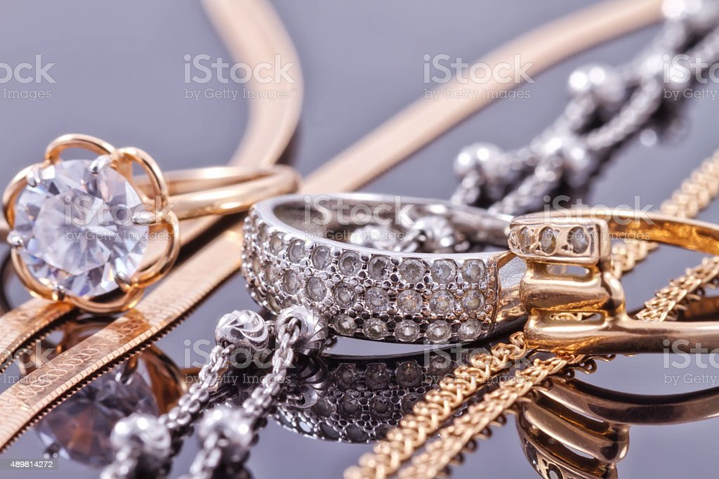 Gold, silver rings and chains stock photo