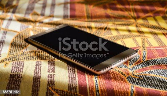 istock Gold smartphone 683751464