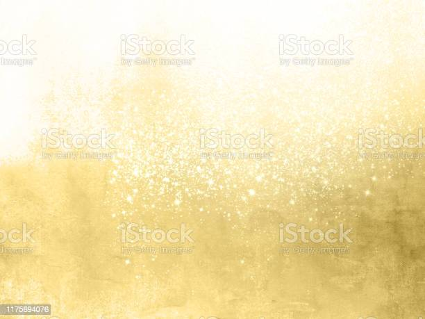 Photo of Gold sparkle background - abstract festive backdrop with glittering stars