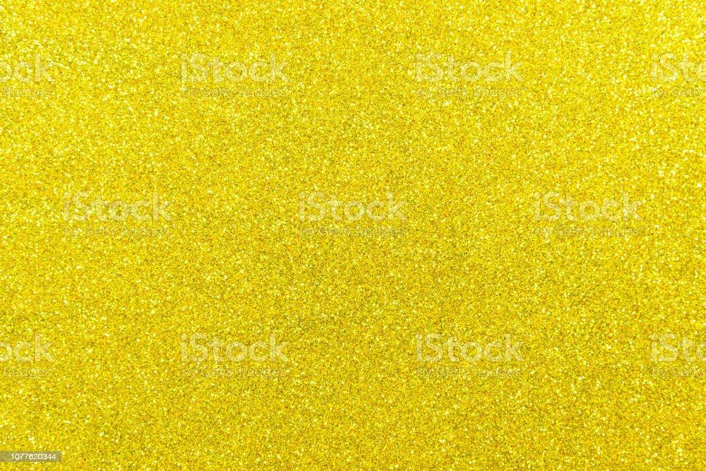 Gold sparkle glitter background - close up
