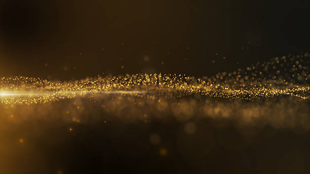 Gold sparkling particles wave background stock photo