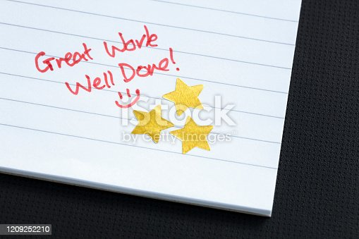 Excellent work gold star award on notepad
