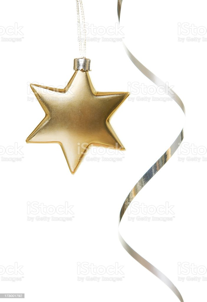 Gold star ornament with silver ribbon on white background stock photo