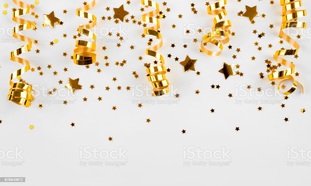 Gold stars confetti and curled ribbons isolated on white background stock photo