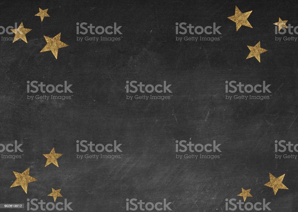 gold stars on blackboard stock photo