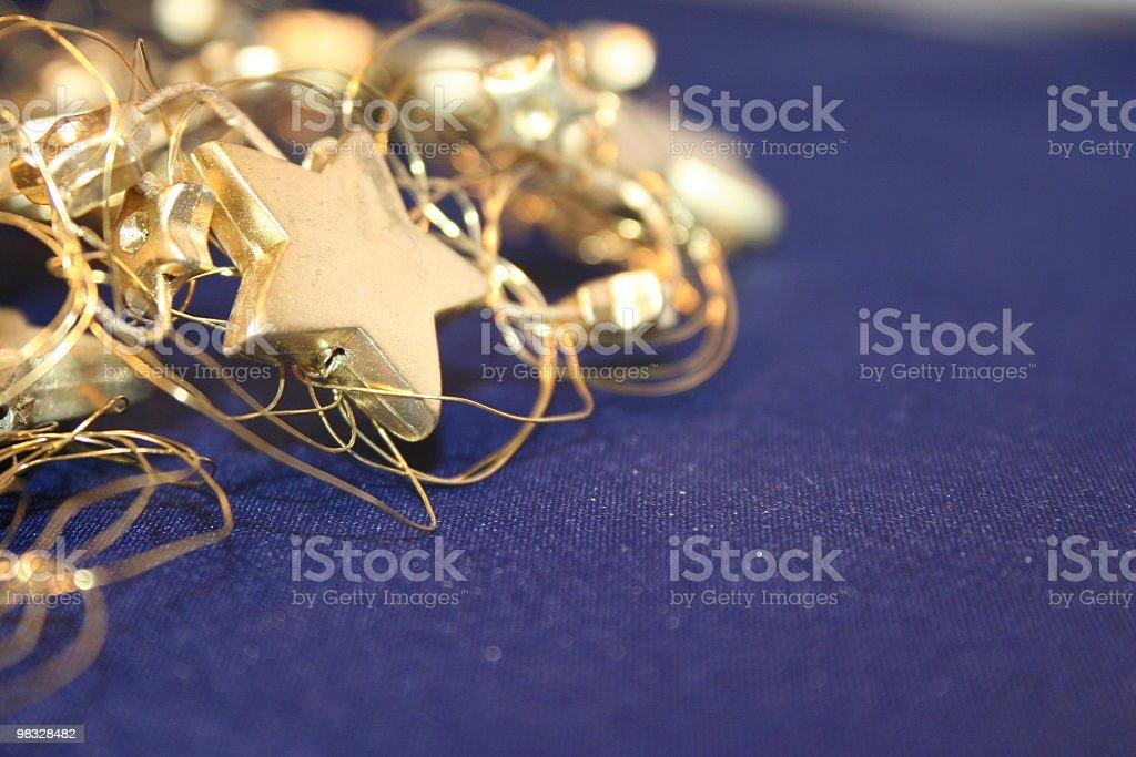 Oro stelle su sfondo blu foto stock royalty-free