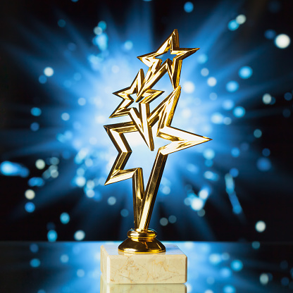 istock gold stars trophy against shiny sparks background 1028956456