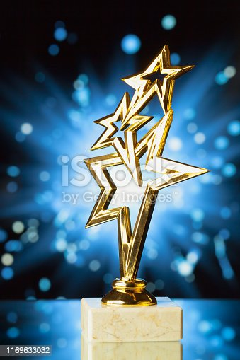 498910514istockphoto gold stars trophy against shiny sparks background 1169633032