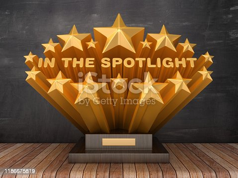 Gold Stars with IN THE SPOTLIGHT Phrase on Trophy - Chalkboard Background - 3D Rendering