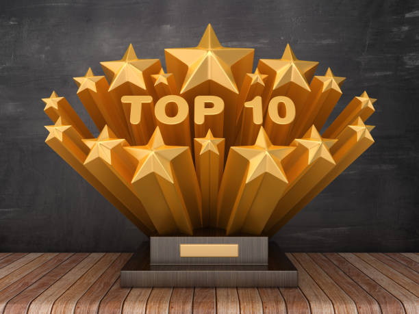 Gold Stars with TOP 10 Word  on Trophy - Chalkboard Background - 3D Rendering Gold Stars with TOP 10 Word  on Trophy - Chalkboard Background - 3D Rendering high section stock pictures, royalty-free photos & images