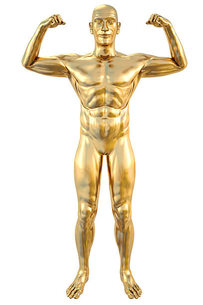 A gold statue facing forward and flexing both arms stock photo
