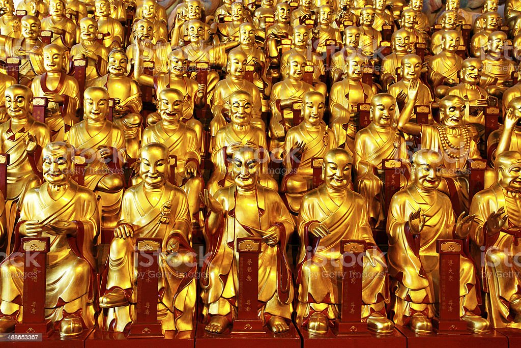 Gold statues of the Lohans stock photo