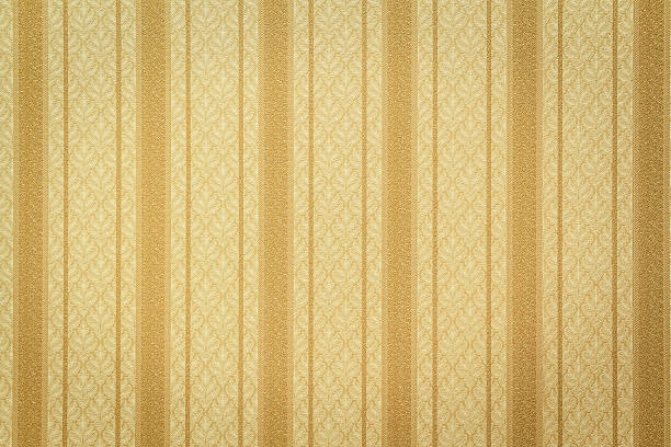 Gold striped wallpaper with floral pattern Antique style striped gold wallpaper 20th century style stock pictures, royalty-free photos & images