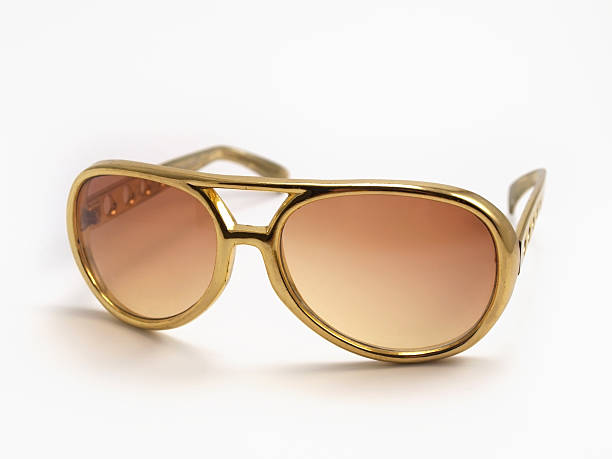 gold sunglasses - elvis stock photos and pictures