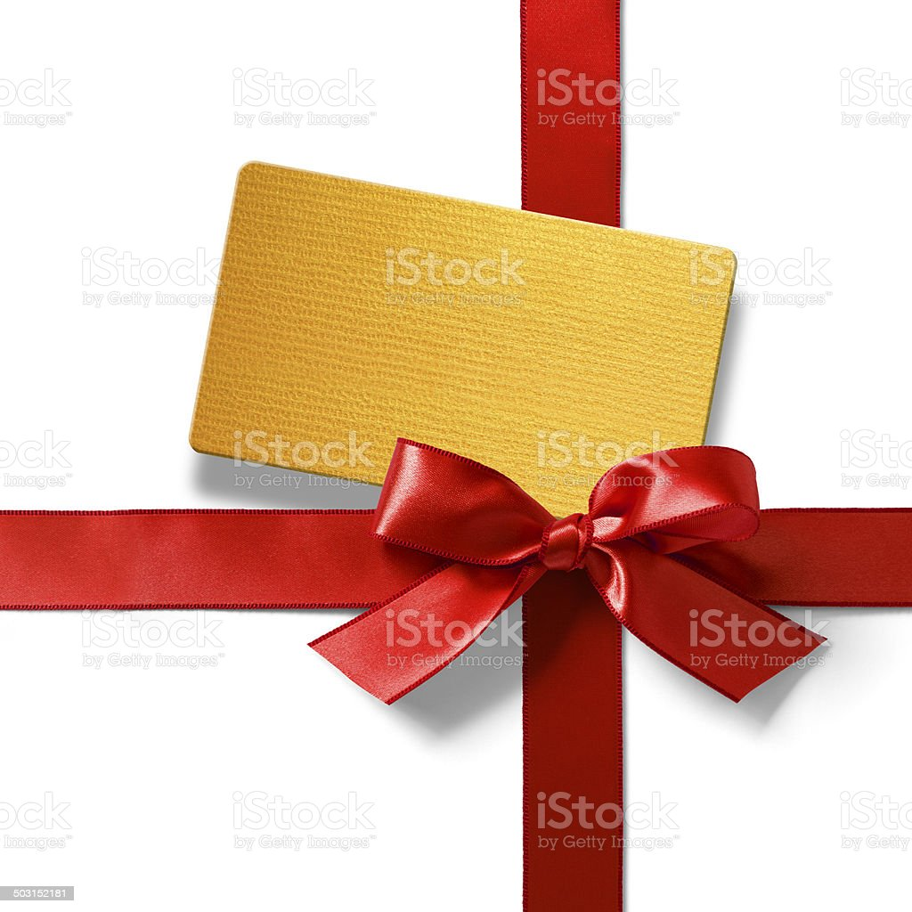 Gold tag with red satin ribbon stock photo