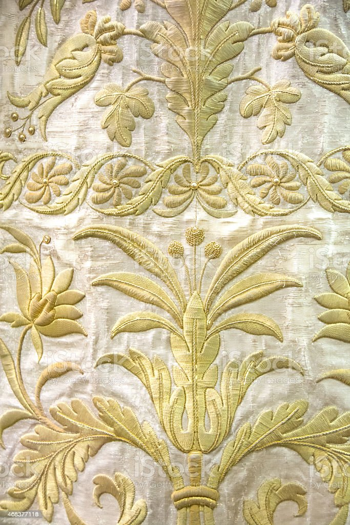 Gold tapestry several hundred years old in Florence, Italy stock photo