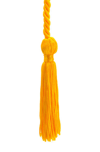 Gold Tassle Small Gold Tassel Cut Out on a White Background. tassel stock pictures, royalty-free photos & images