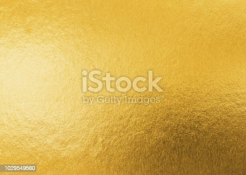 Gold texture background metallic golden foil or shinny wrapping paper bright yellow wall paper for design decoration element