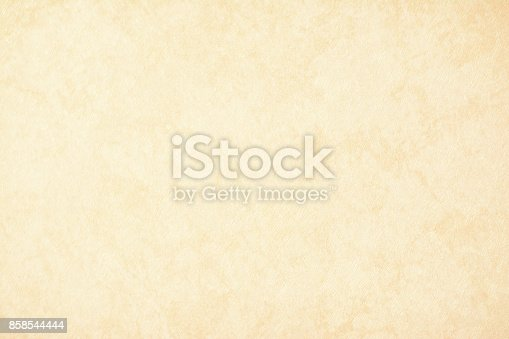 istock gold texture background paper in yellow vintage cream or beige color, parchment paper, abstract pastel gold gradient with brown, solid website background 858544444