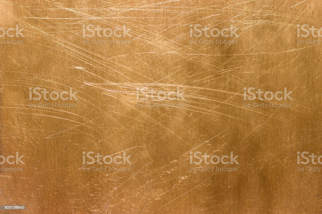 gold texture, golden color of the metal sheet stock photo