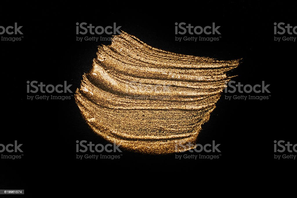Gold textured painting on black background. Texture of black gold. stock photo